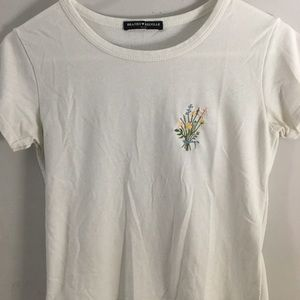 White brandy Melville crop top with bouquet design